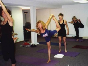 Francoise demonstrating Dancer's Pose in a Yoga class